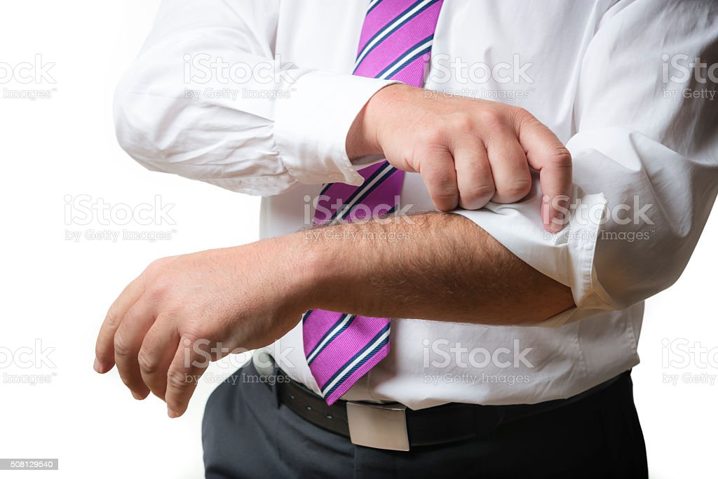 Business Man rolls up sleeves stock photo