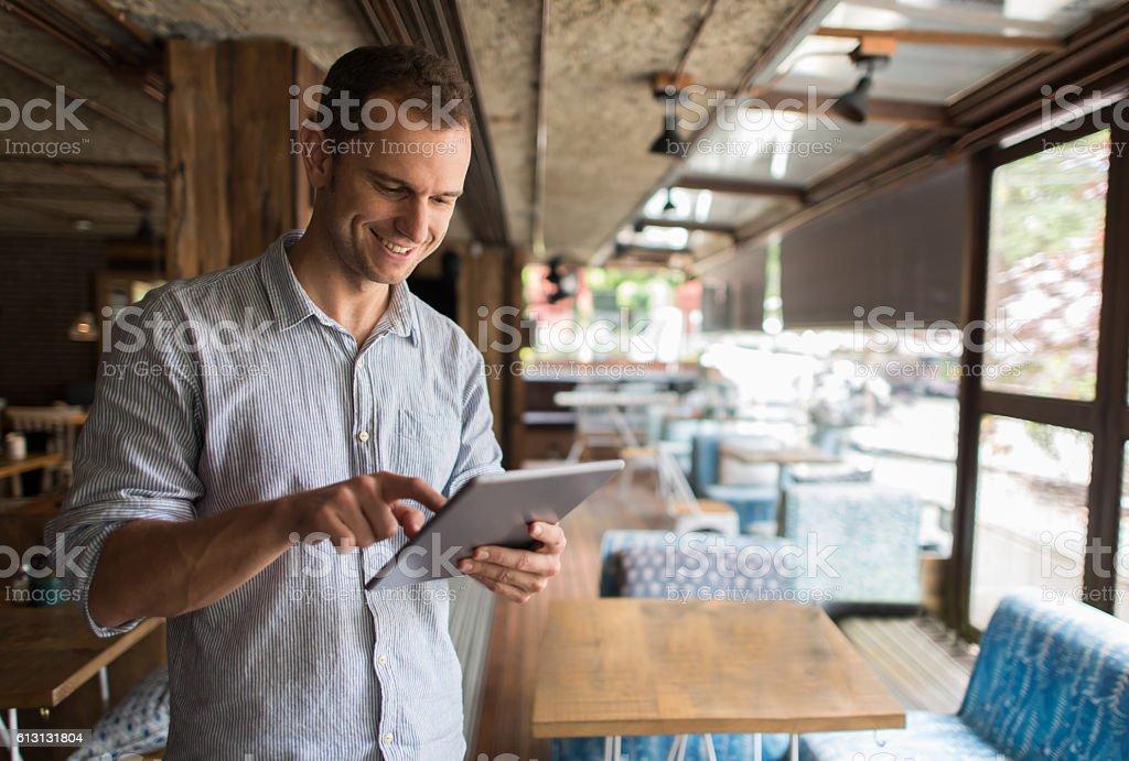Business man running a restaurant stock photo