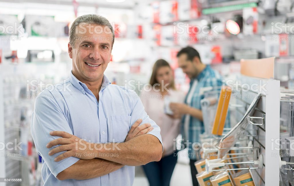 Business man running a technology store stock photo