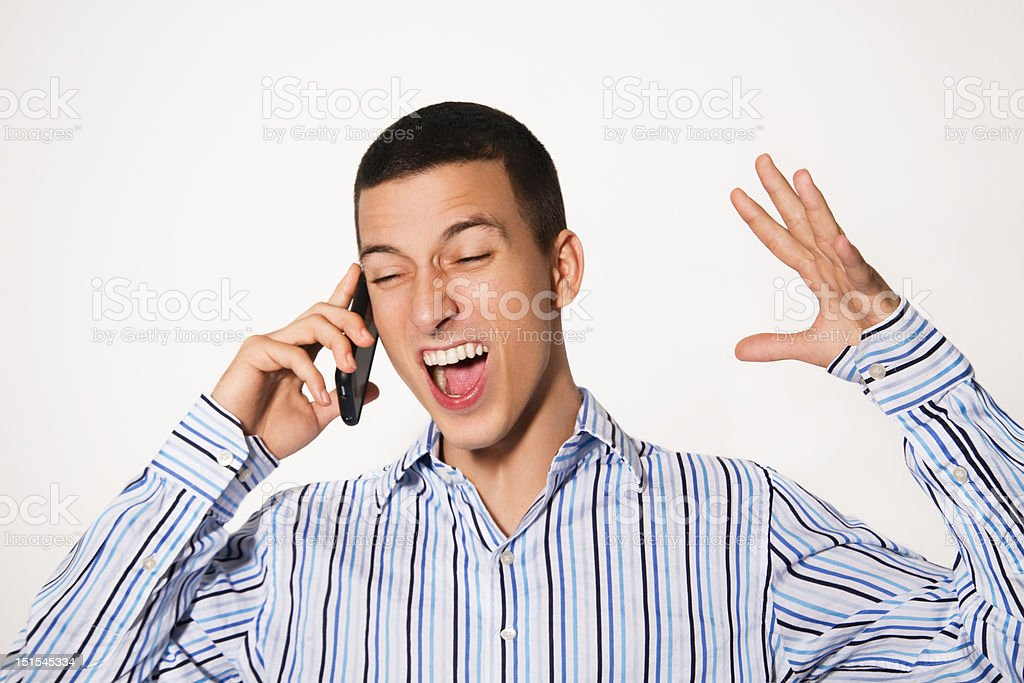 Business man screaming on phone royalty-free stock photo