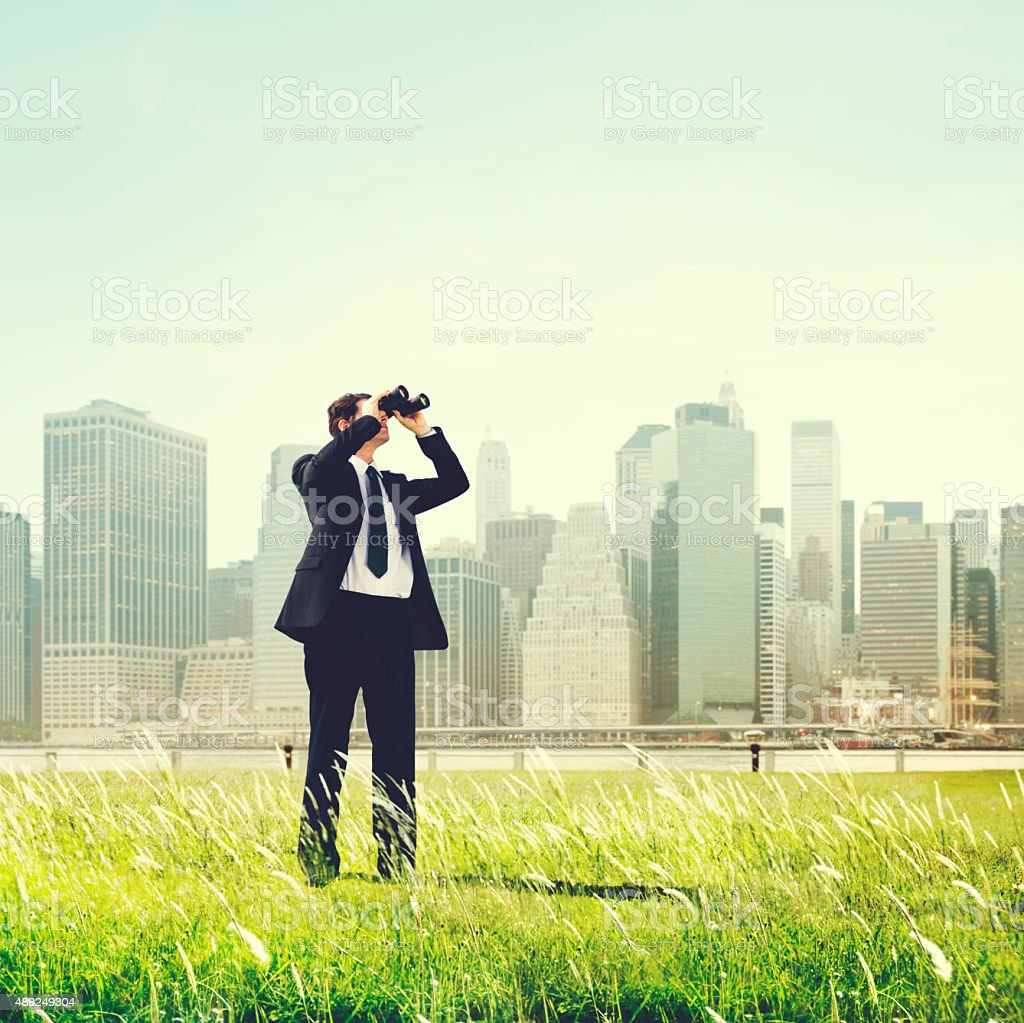 Business Man Searching Binoculars Outdoors Concept stock photo