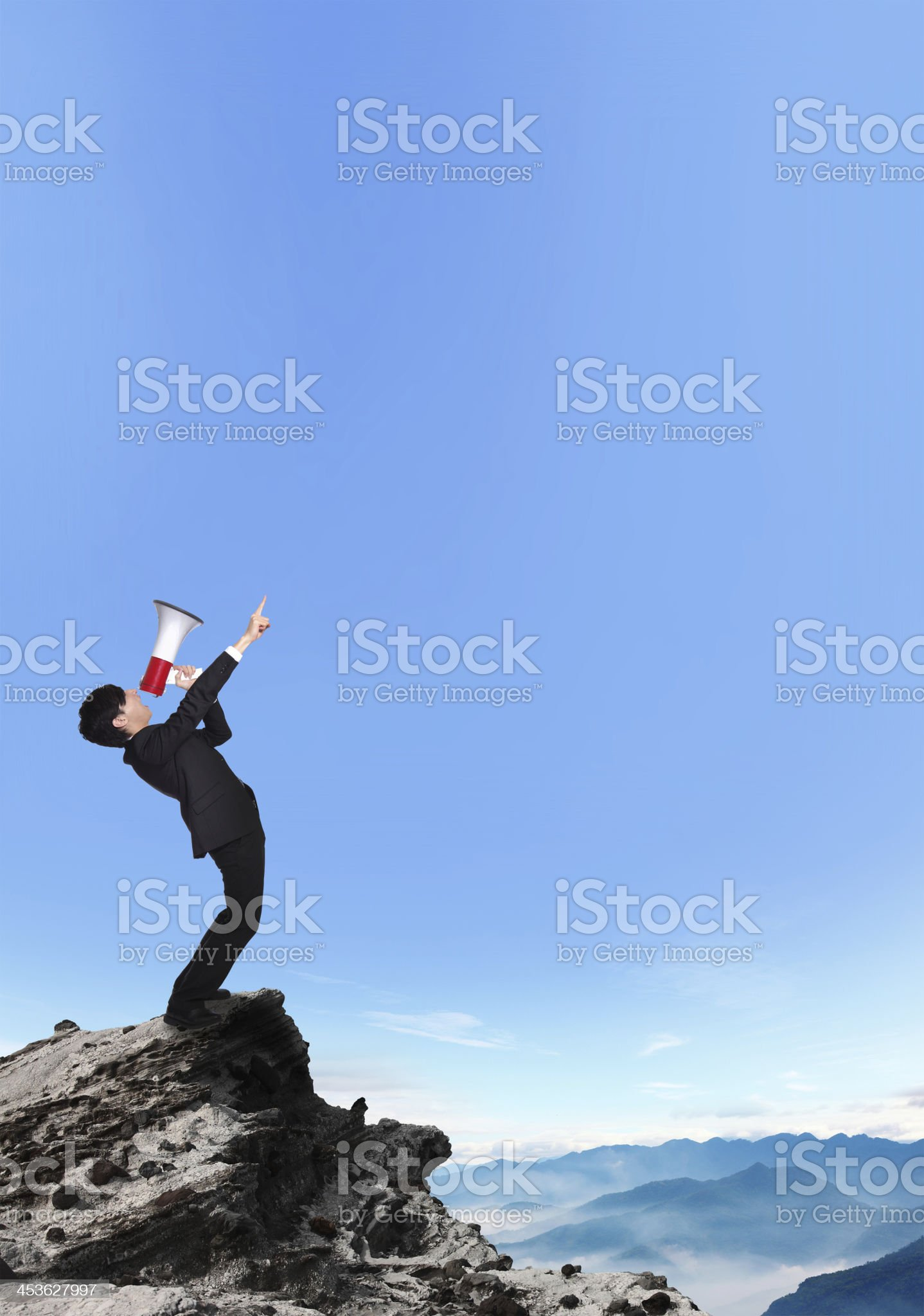 business man shouting into a megaphone royalty-free stock photo