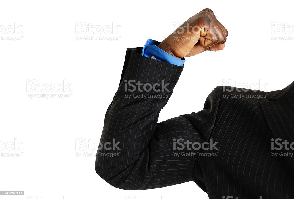 Business man showing bicep stock photo