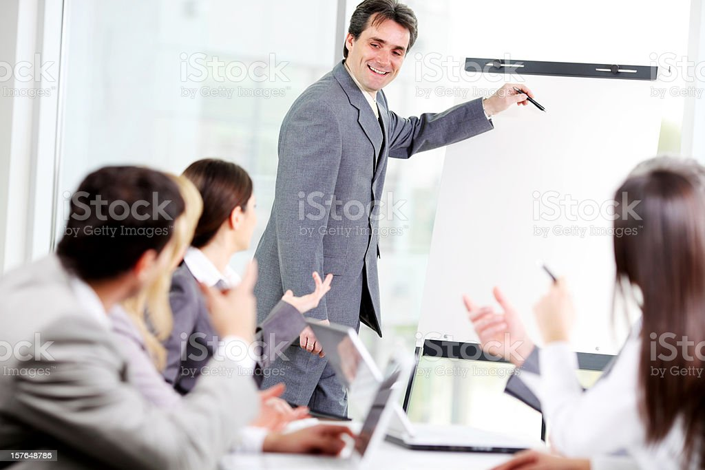 Business man showing plan of work at the flipchart. royalty-free stock photo