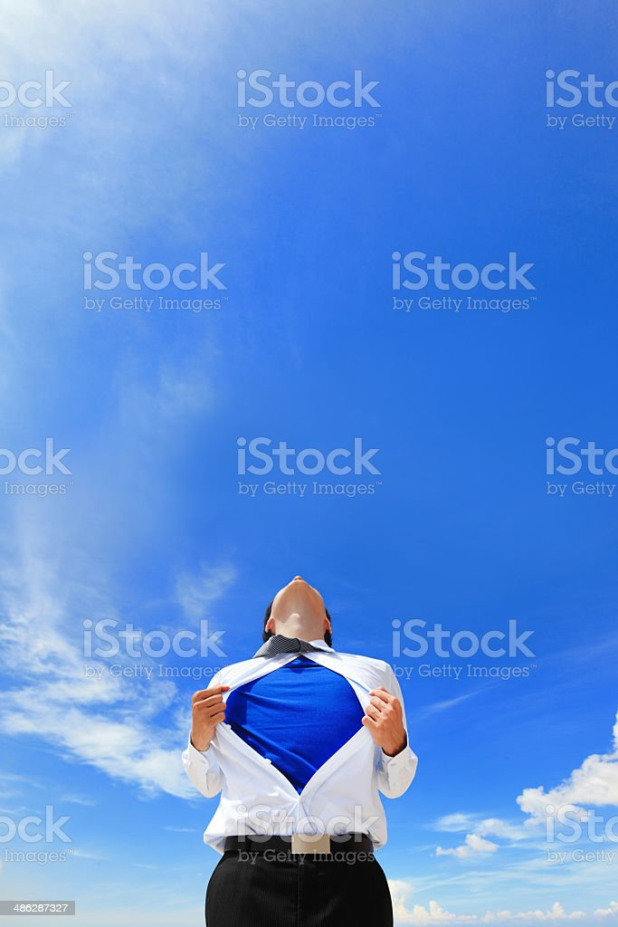 Business man showing superhero suit stock photo