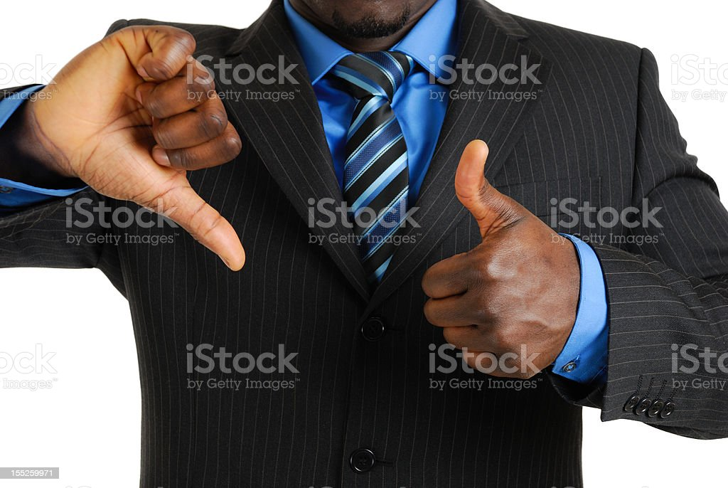 Business man showing thumbs up and down royalty-free stock photo