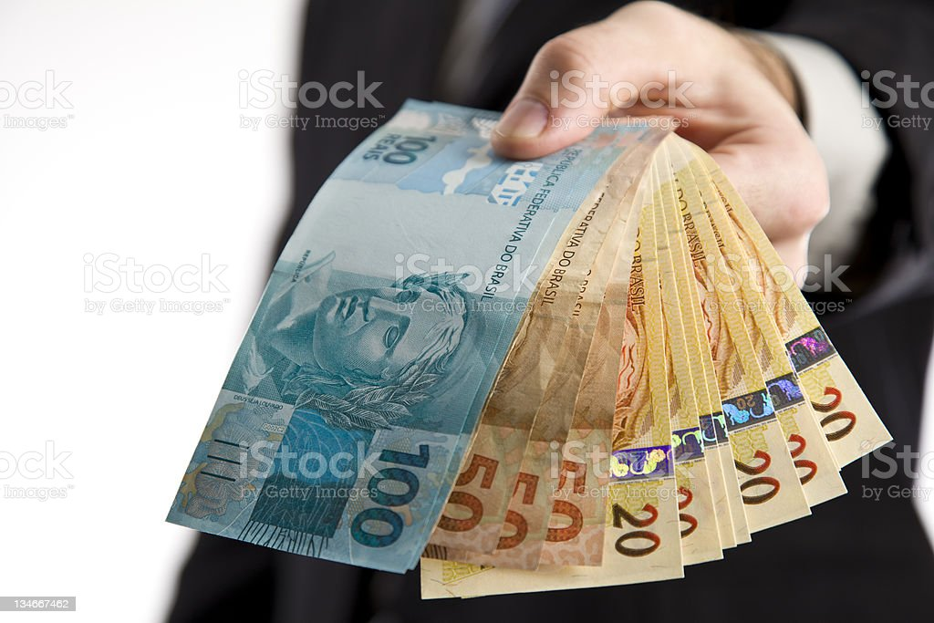 Business man showing you money stock photo