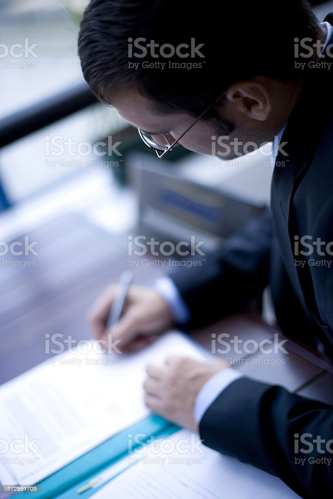 Business man signs a document royalty-free stock photo
