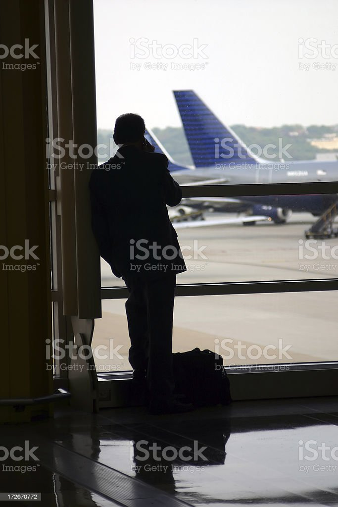 Business Man Silhouette at Airport royalty-free stock photo