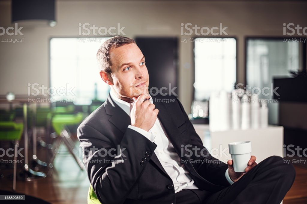 Business man sitting in a office with coffee royalty-free stock photo
