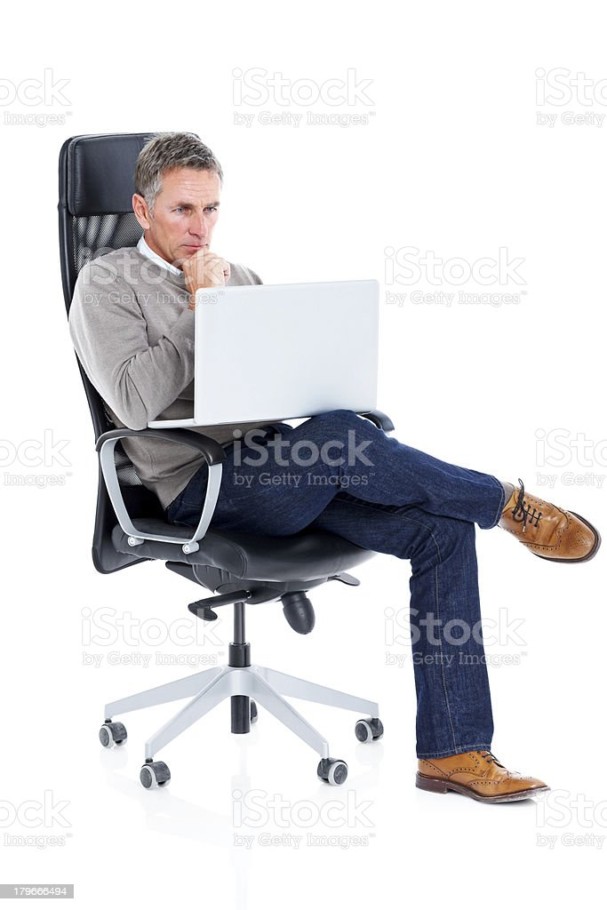Business man sitting in chair looking at laptop and thinking royalty-free stock photo