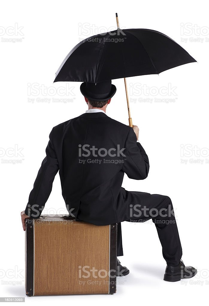 Business Man Sitting on a Briefcase with an Umbrella royalty-free stock photo