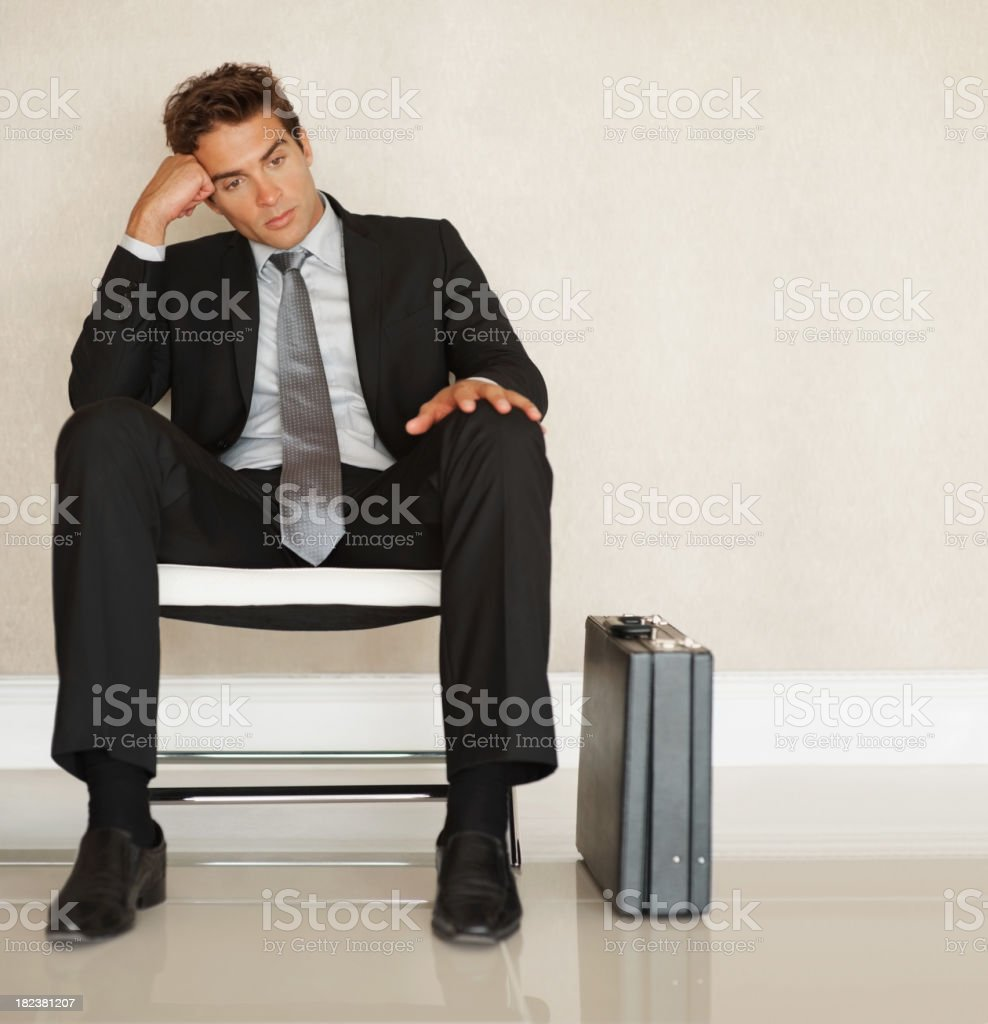 Business man sitting on a chair royalty-free stock photo