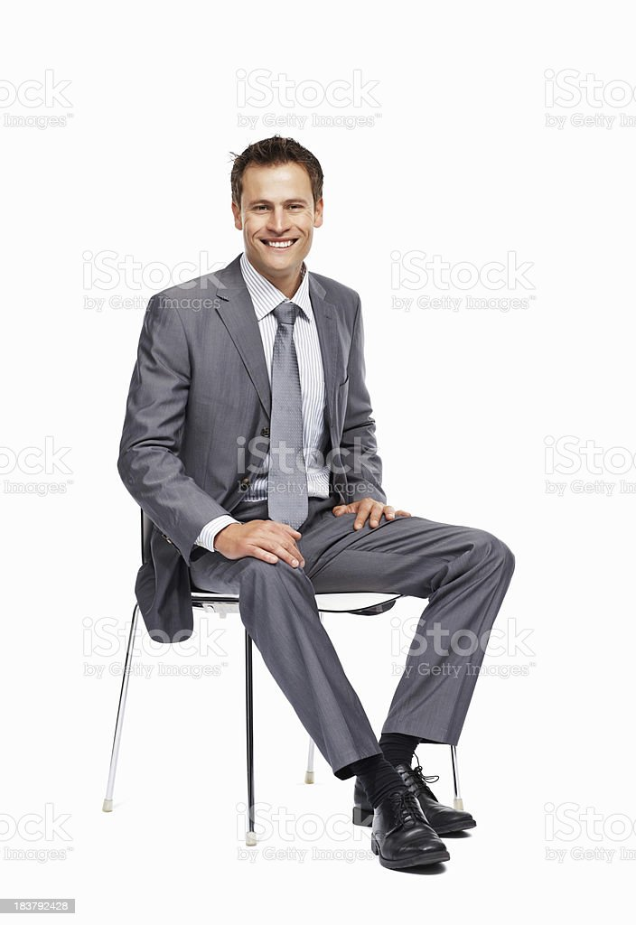 Business man sitting on chair smiling royalty-free stock photo