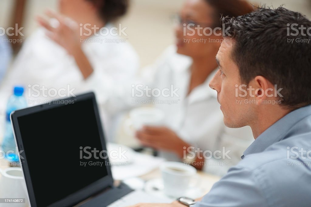 Business man sitting with a laptop for a meeting stock photo