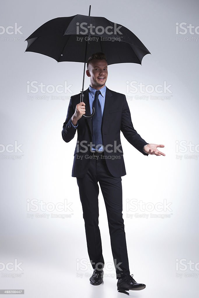 business man smiles at you with umbrella royalty-free stock photo