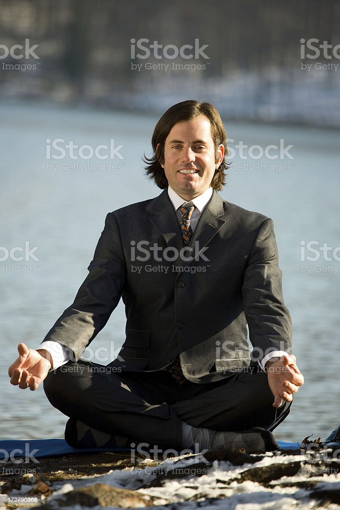 Business Man smiles in Lotus Position royalty-free stock photo