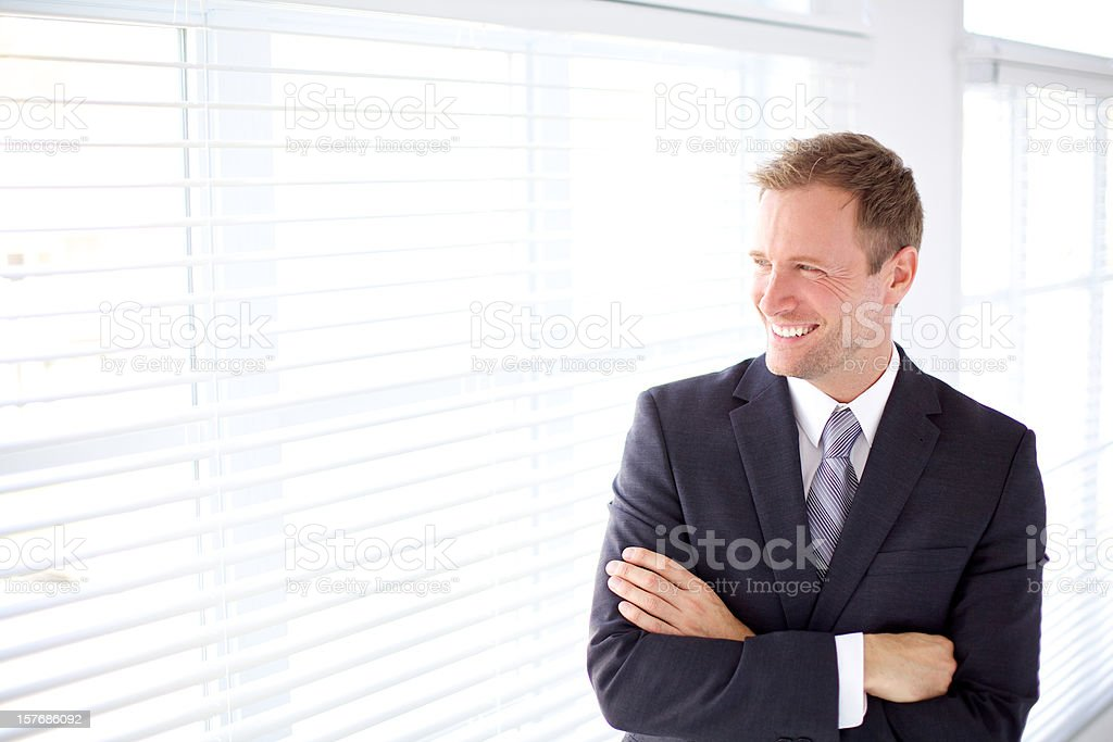 Business man smiling and looking away royalty-free stock photo