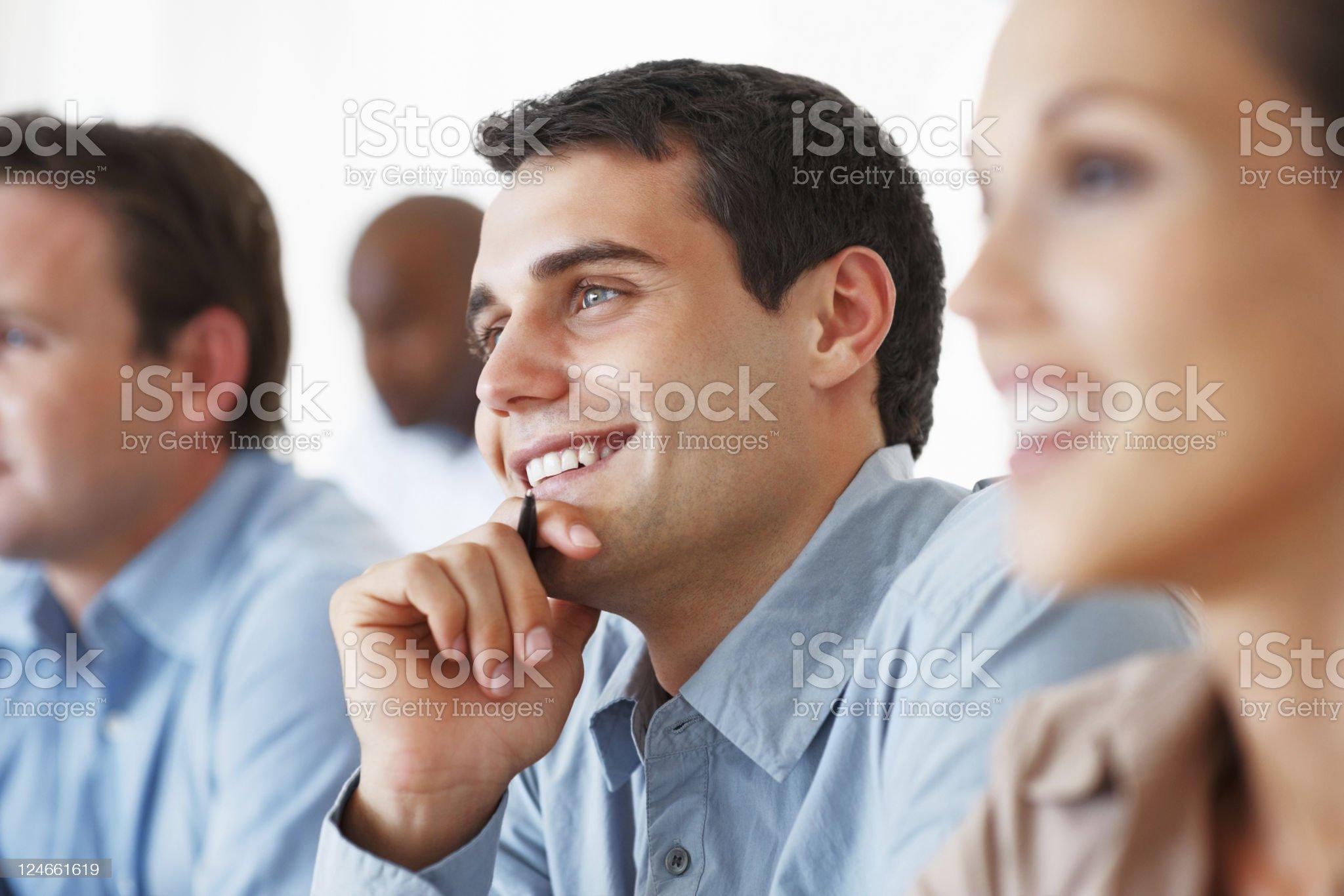 Business man smiling during seminar royalty-free stock photo