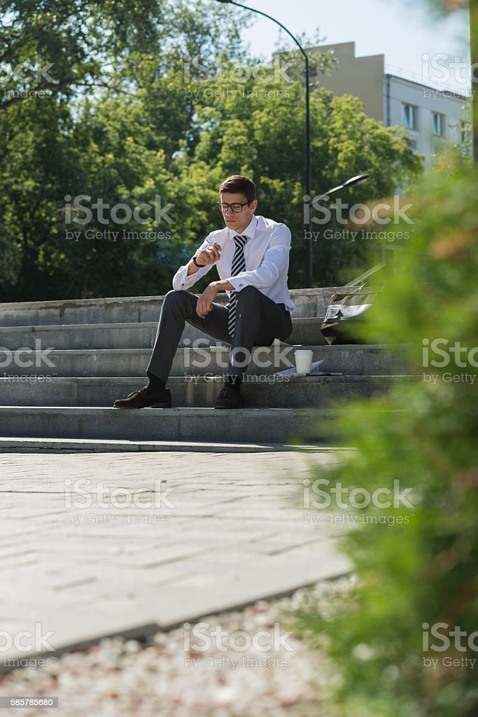 Business man smoking stock photo