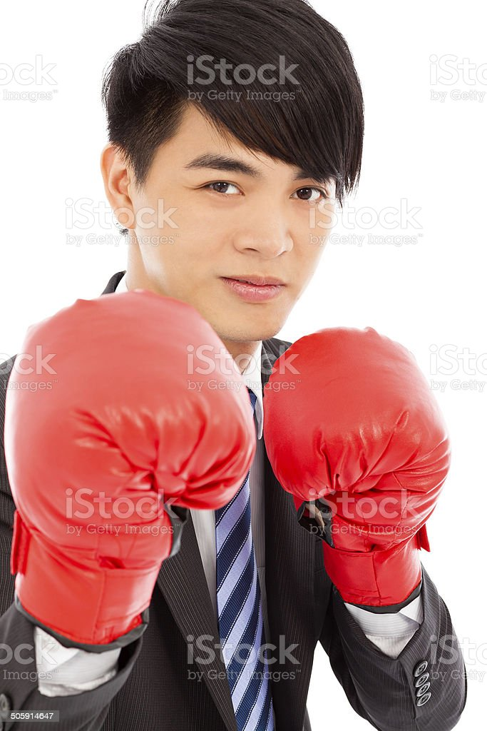 Business man sneer  and ready to fight with boxing gloves royalty-free stock photo