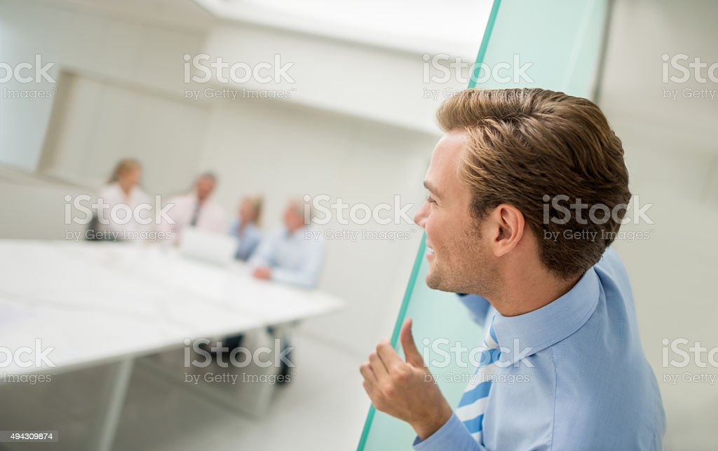 Business man spying at the office stock photo