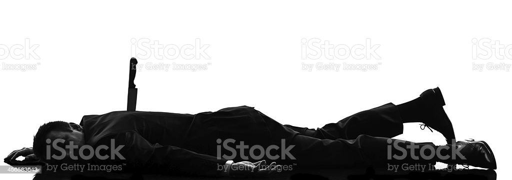 business man Stabbed in the Back silhouette stock photo