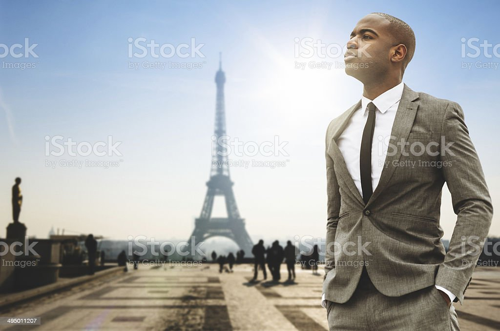 Business man standing against the Tour Eiffel stock photo