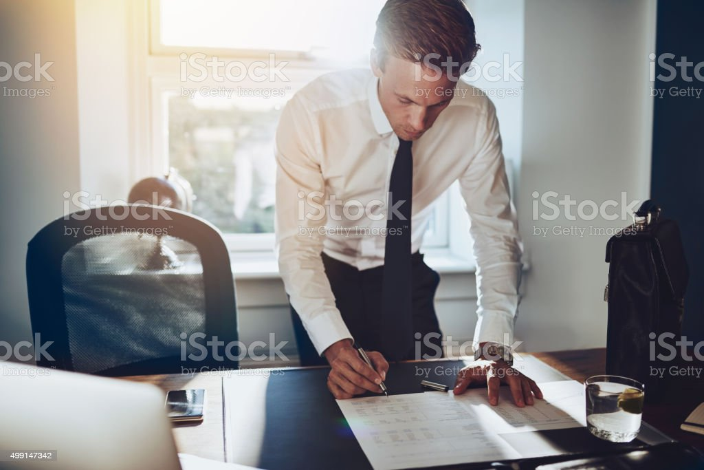 Business man standing at desk stock photo
