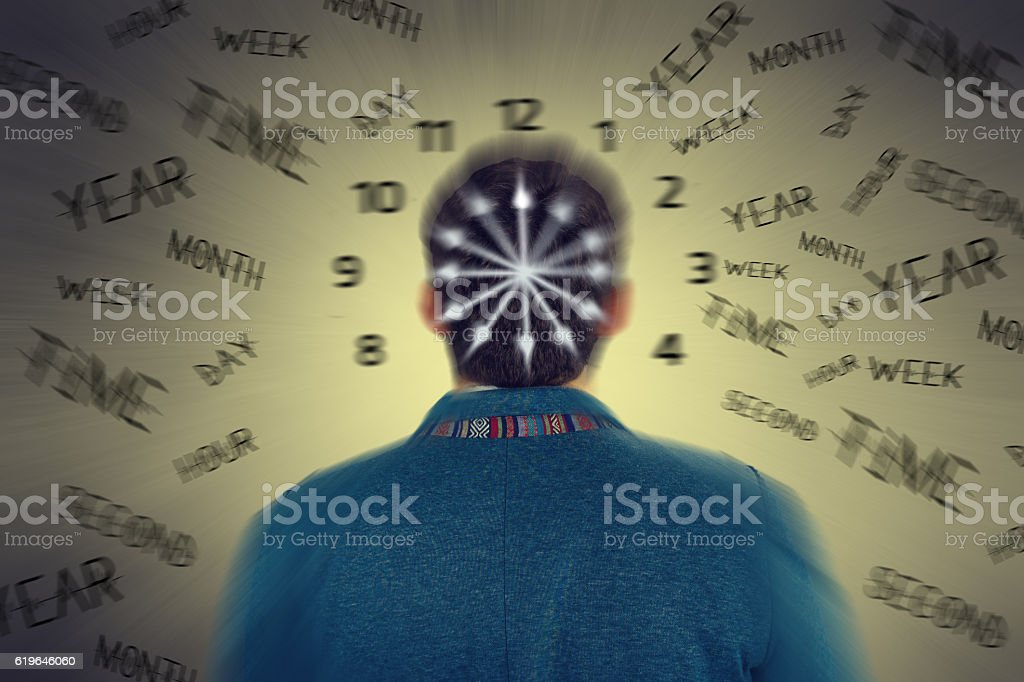 Business man standing in front of passing time stock photo