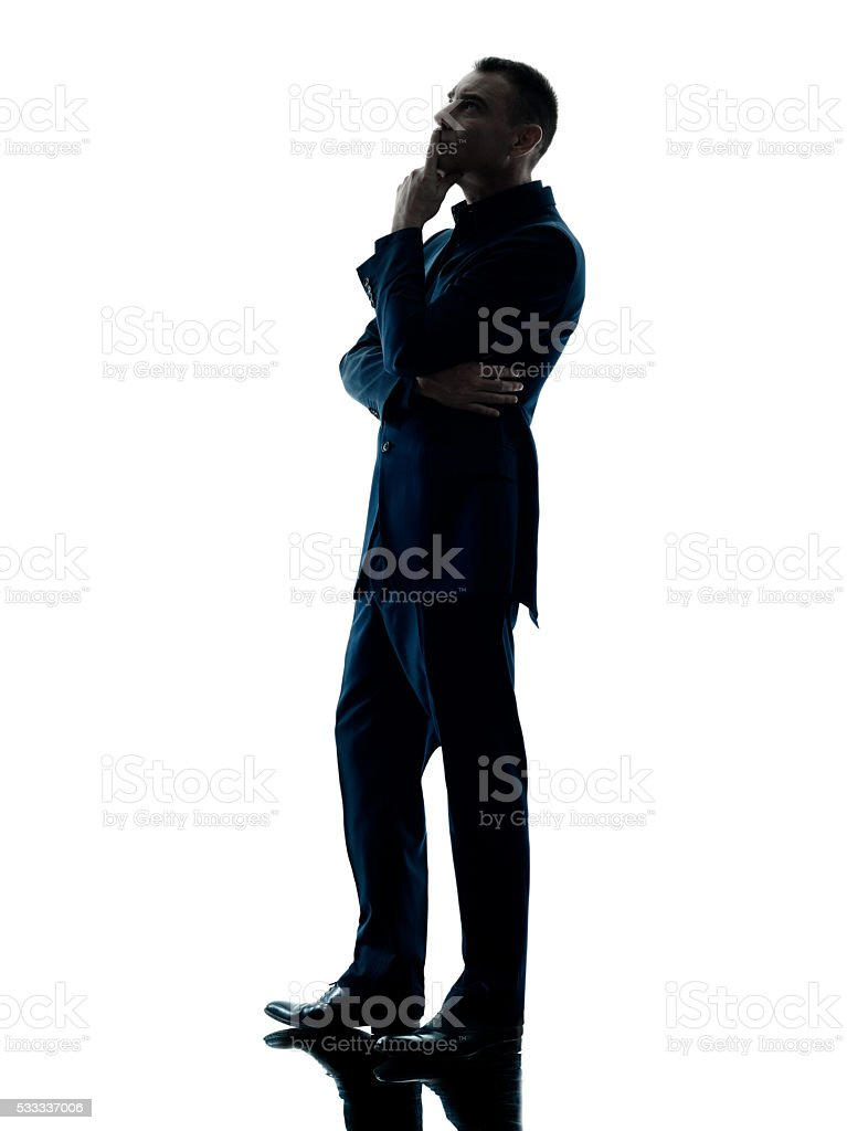 business man standing thinking isolated stock photo