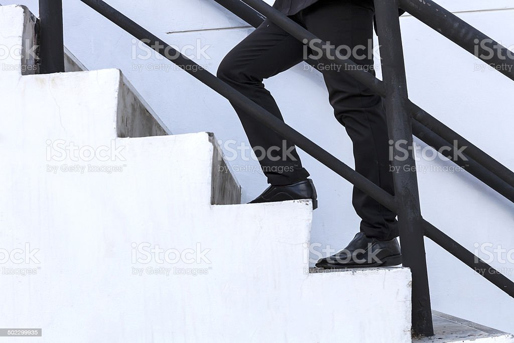 business man step up on stair, success, advancement stock photo
