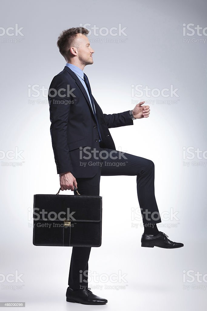 business man steps with briefcase stock photo