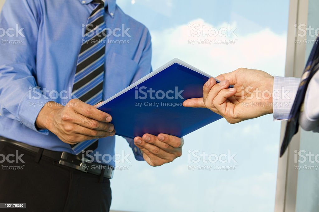 Business man submitting a report stock photo