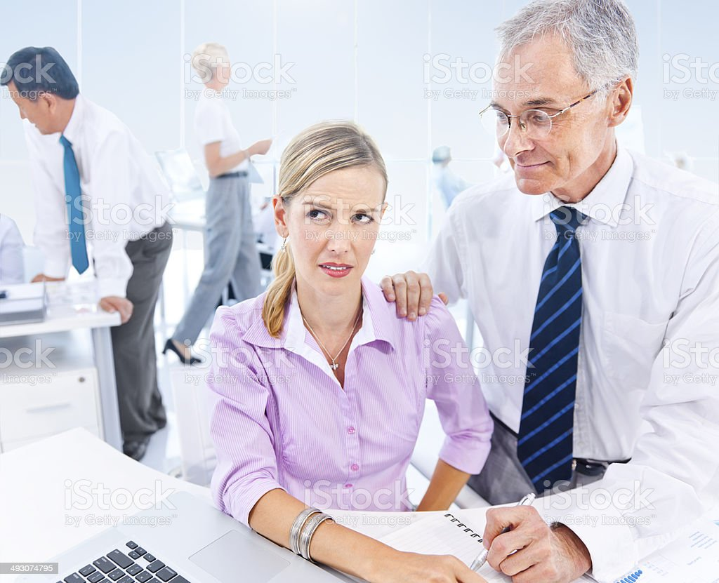 Business Man Subtly Sexual Harassing The Business Woman stock photo