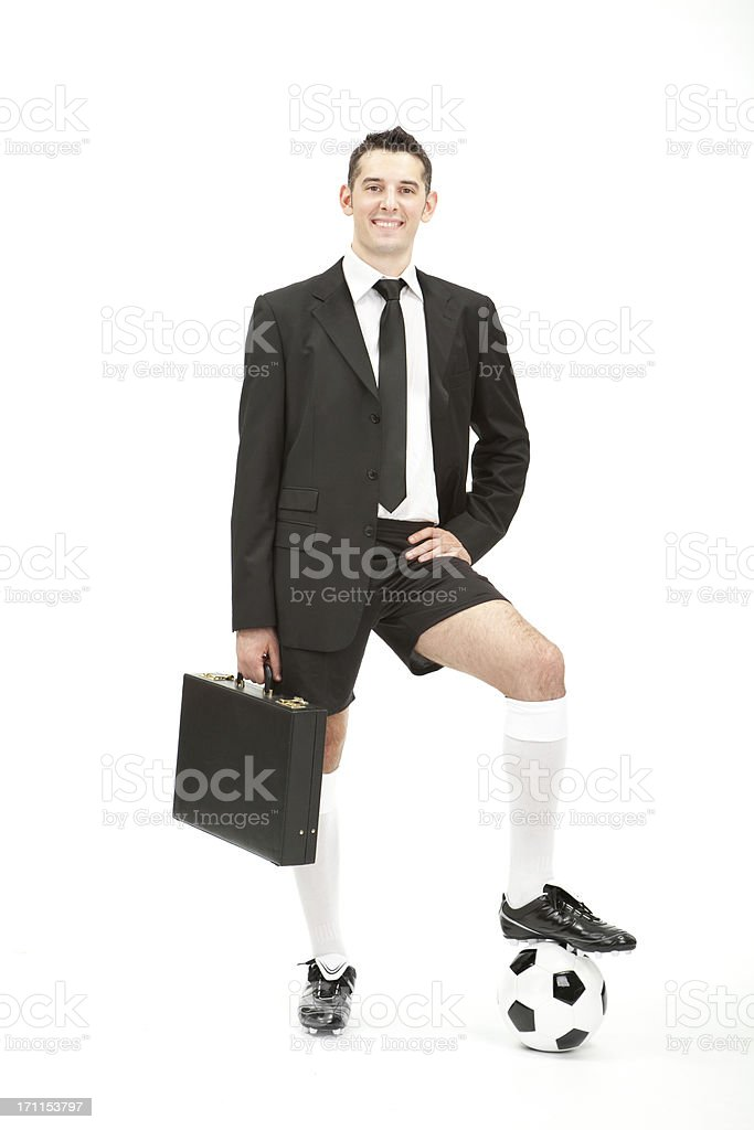 Business man suit and soccer wear posing with football royalty-free stock photo