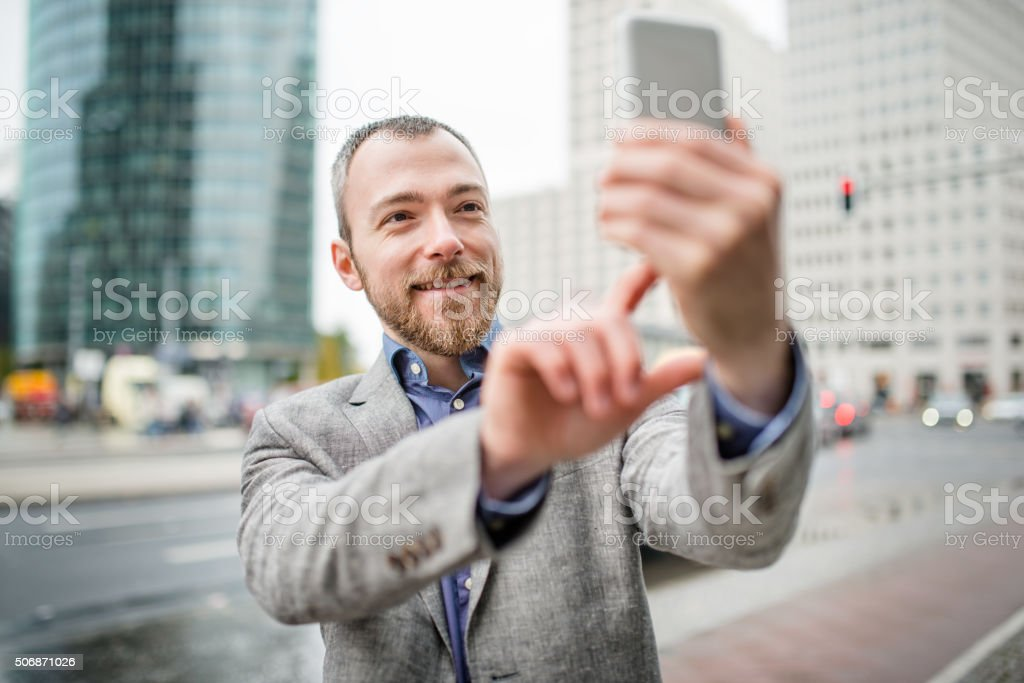 Business man take a selfie on the city stock photo
