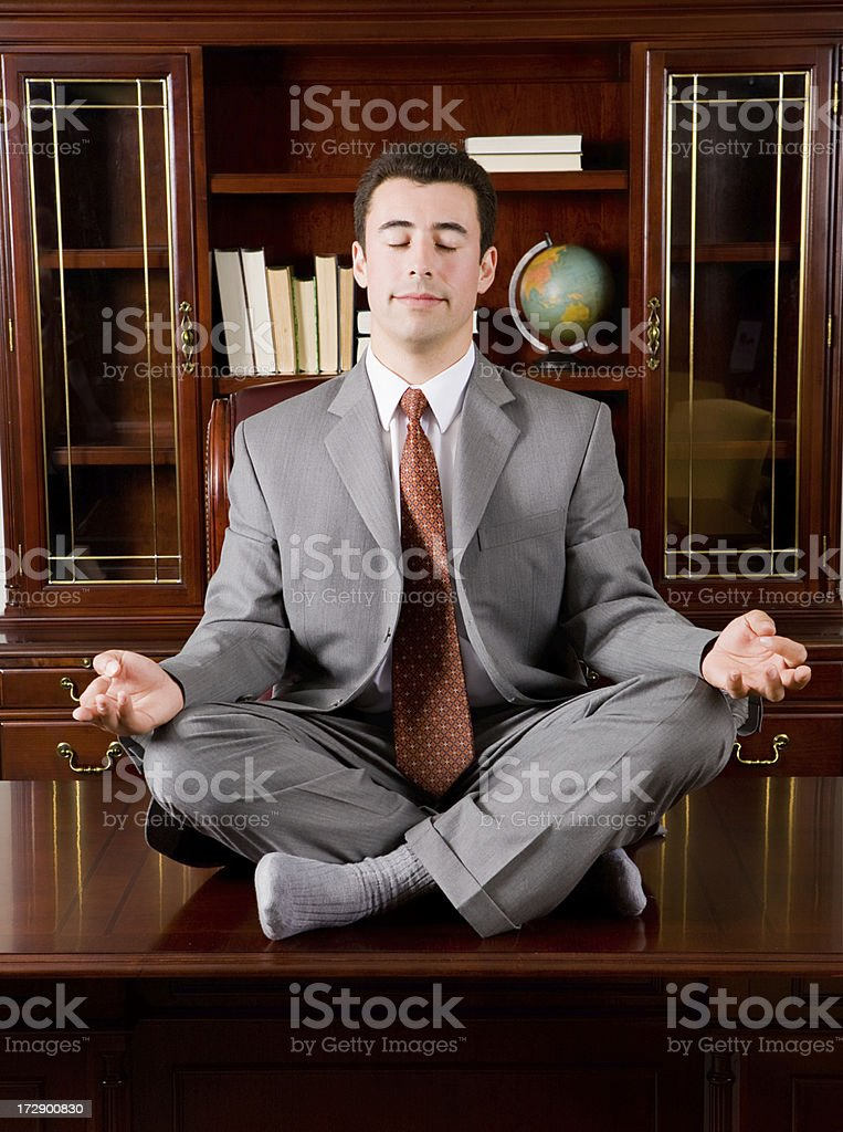Business man takes a meditation break royalty-free stock photo