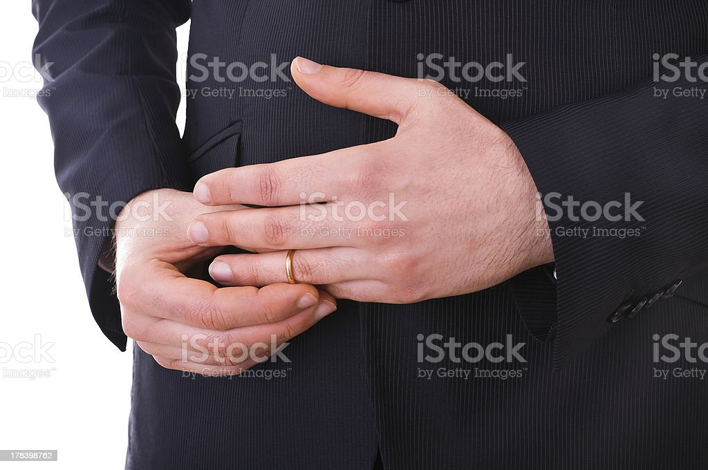 Business man taking off his wedding ring. stock photo