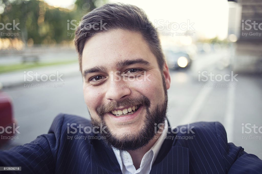 Business man taking selfie stock photo