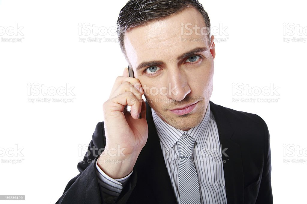 Business man talking on his mobile phone stock photo
