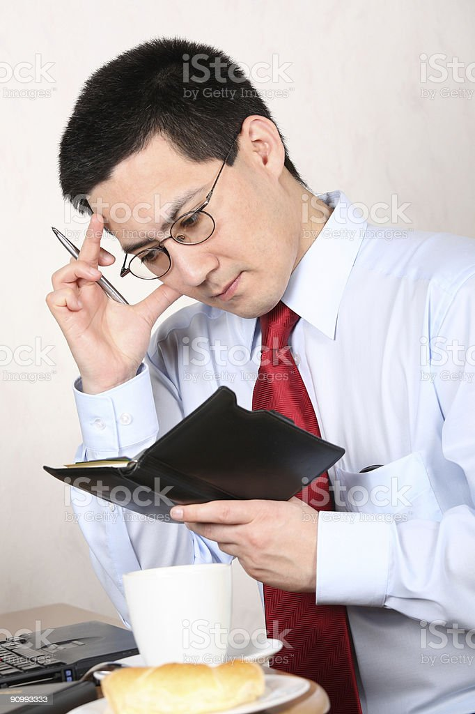 Business Man thinking and planning at Breakfast royalty-free stock photo