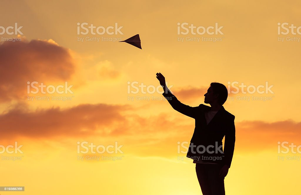 Business man throwing paper plane stock photo