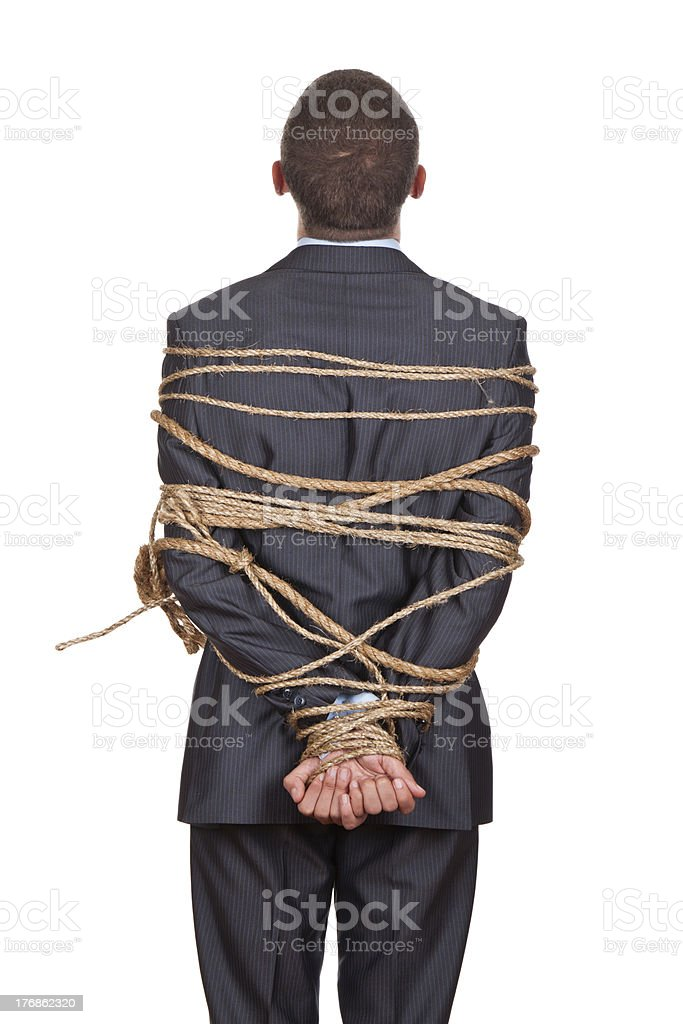 business man tied rope stock photo