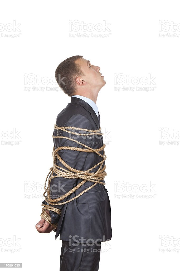 business man tied rope royalty-free stock photo