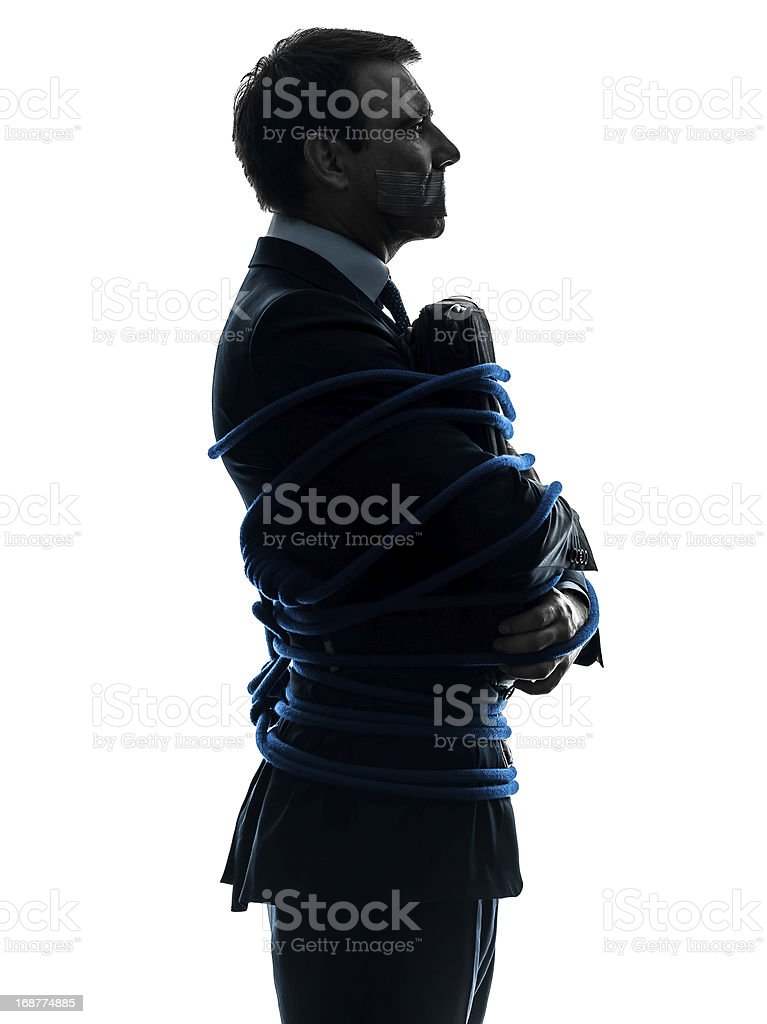 business man tied up prisoner silhouette royalty-free stock photo