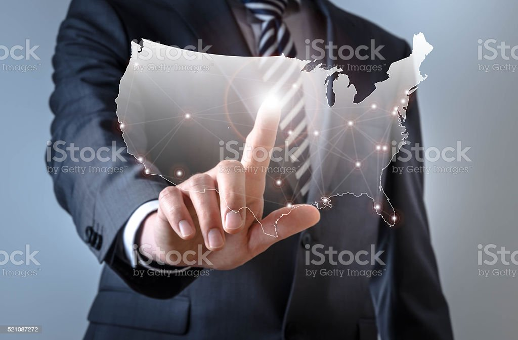 Business man touches a screen with an USA map symbol stock photo