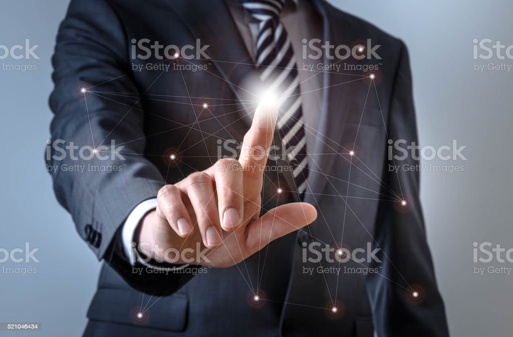 Business man touches a screen with connections stock photo
