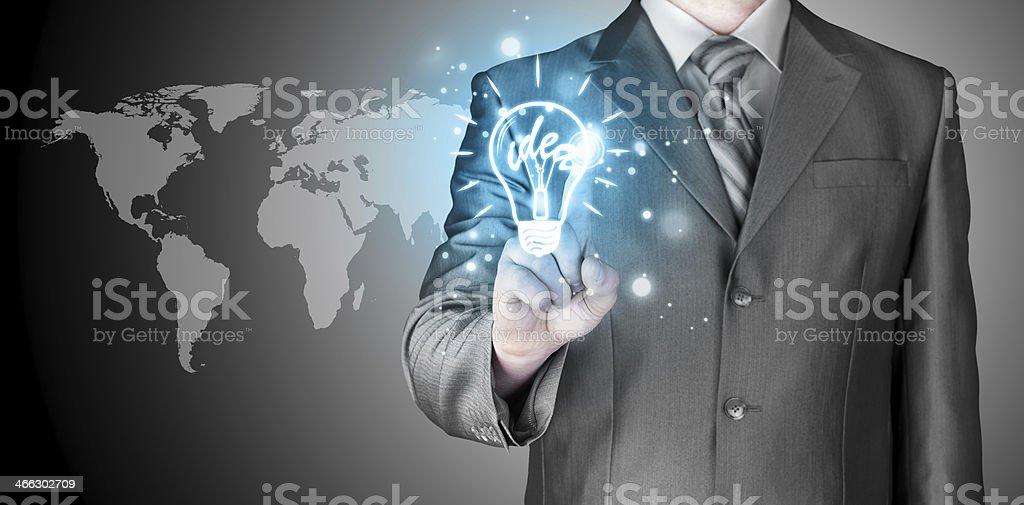 Business man touching light of idea stock photo