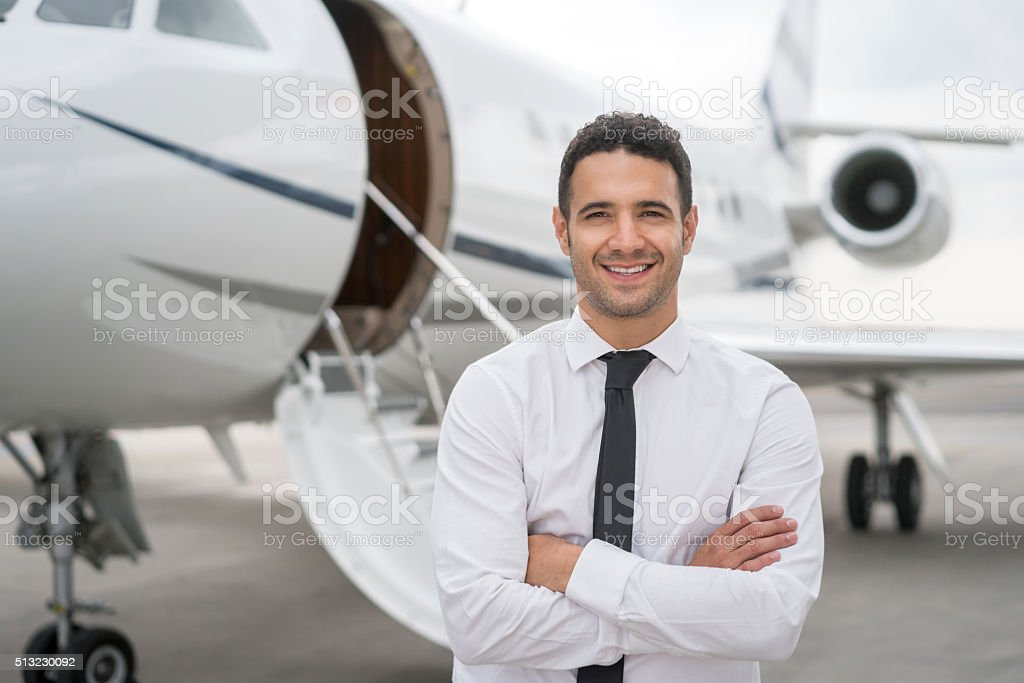 Business man traveling by plane stock photo